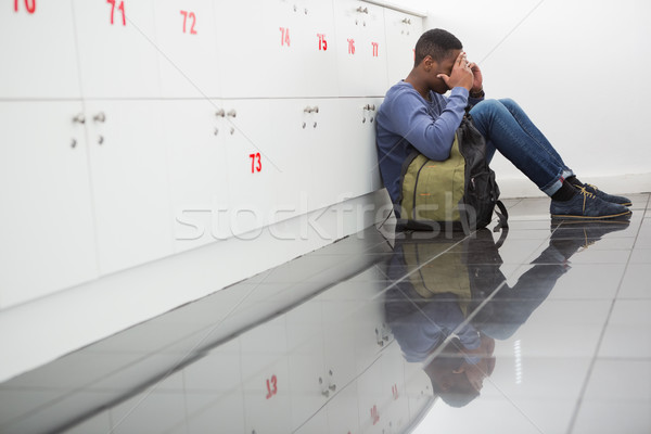 University student sitting alone with his hands on face Stock photo © wavebreak_media