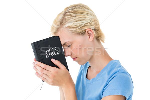 Pretty blonde woman holding bible Stock photo © wavebreak_media
