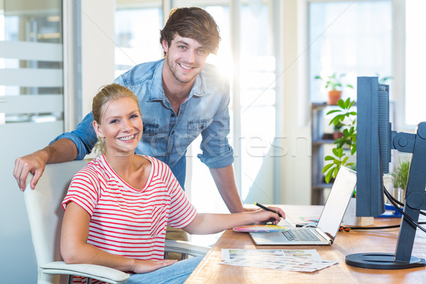 Smiling team working with digitizer and laptop Stock photo © wavebreak_media