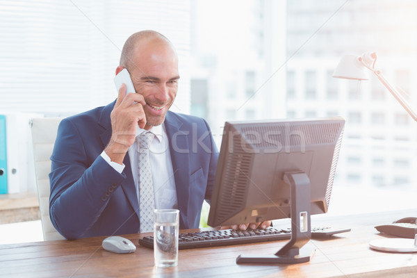 Smiling businessman on the phone Stock photo © wavebreak_media