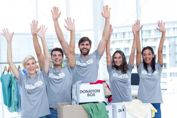 Volunteers raising their hands Stock photo © wavebreak_media