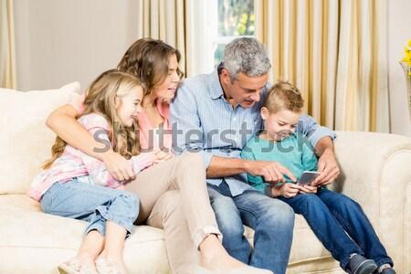 Rodziców dzieci sofa gry szczeniak domu Zdjęcia stock © wavebreak_media