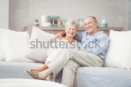 Happy couple with pet cat on floor Stock photo © wavebreak_media