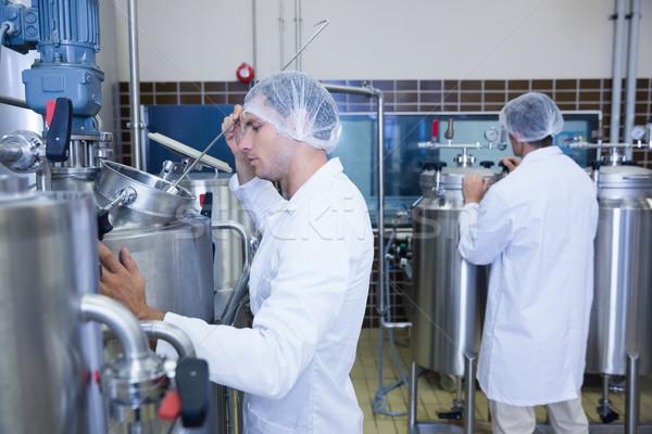 Cientistas jaleco cabelo com fábrica Foto stock © wavebreak_media