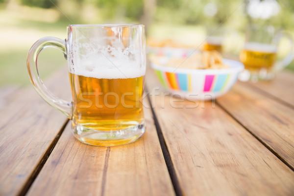 Bière collations printemps pelouse Photo stock © wavebreak_media