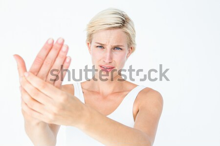 Angry pretty blonde showing her hand  Stock photo © wavebreak_media