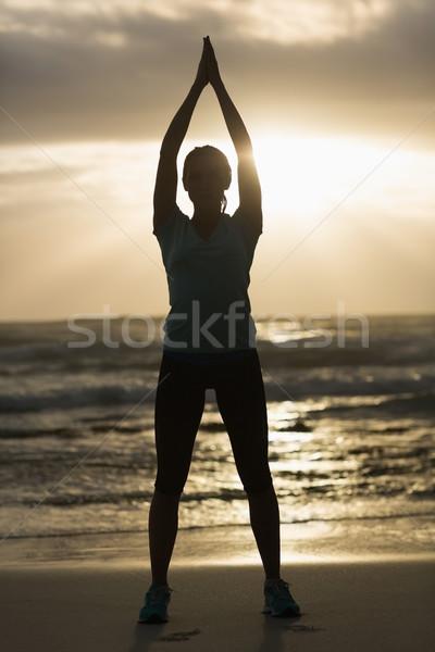 スポーティー ブルネット ストレッチング ビーチ 健康 ストックフォト © wavebreak_media