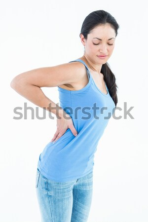Gyönyörű barna hajú szenvedés hátfájás fehér nő Stock fotó © wavebreak_media