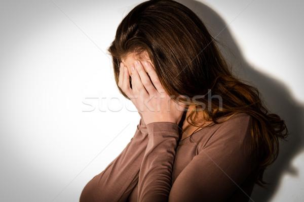 Déprimée femme tête mains blanche triste Photo stock © wavebreak_media