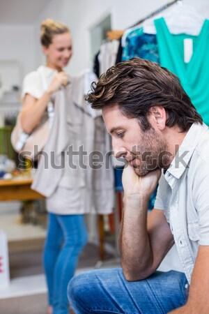 退屈 男 座って ガールフレンド 肖像 服 ストックフォト © wavebreak_media