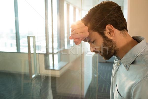 Depressed businessman leaning on glass Stock photo © wavebreak_media