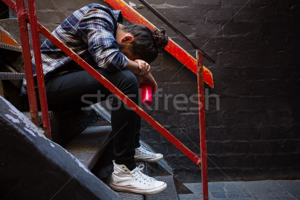Drunk man sitting on staircase Stock photo © wavebreak_media