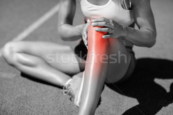 Low section of female athlete suffering from joint pain Stock photo © wavebreak_media