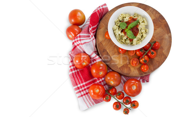Fettuccine pasta with tomatoes, garlic and napkin cloth Stock photo © wavebreak_media