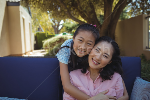 Mother and daughter relaxing on couch outside home Stock photo © wavebreak_media