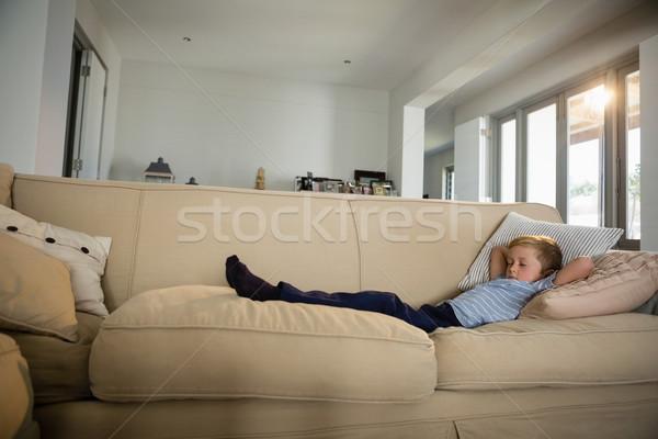 Fiú alszik kanapé nappali otthon internet Stock fotó © wavebreak_media
