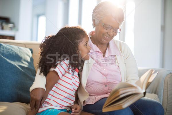 Grandmother and daughter reading book in living room Stock photo © wavebreak_media