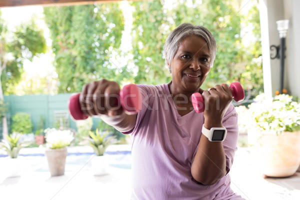 Close up portrait of woman exercising with dumbbell Stock photo © wavebreak_media