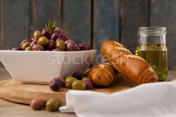 Olives in container by bread and oil Stock photo © wavebreak_media