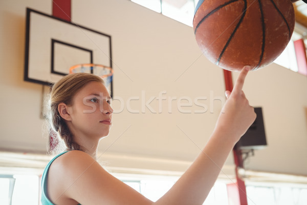 Side view of basketball player balancing ball on finger Stock photo © wavebreak_media