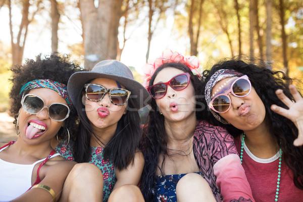 Portré boldog női barátok készít arcok Stock fotó © wavebreak_media
