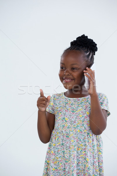 Souriant femme d'affaires pointant parler téléphone mur Photo stock © wavebreak_media