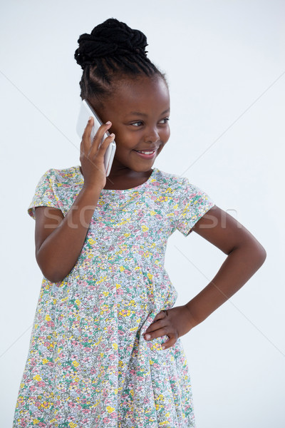 Souriant femme d'affaires main hanche parler téléphone Photo stock © wavebreak_media
