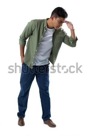 Man shielding eyes on white background Stock photo © wavebreak_media