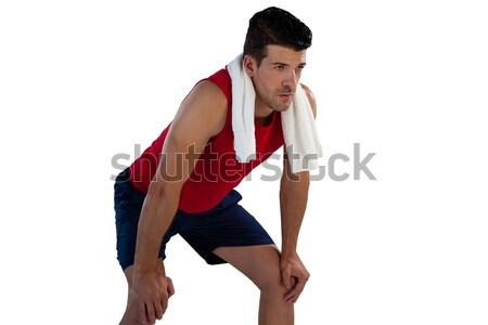 Sportsman with napkin looking away white bending Stock photo © wavebreak_media