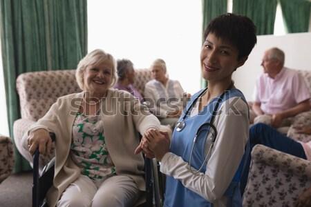Senior friends consoling male friend Stock photo © wavebreak_media