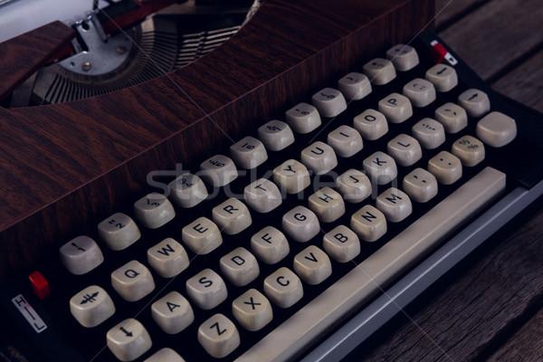 Close-up of vintage typewriter on wooden table Stock photo © wavebreak_media