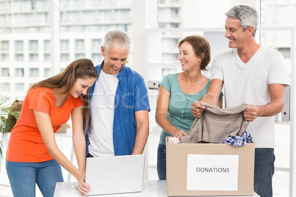 Casual business people sorting donations Stock photo © wavebreak_media