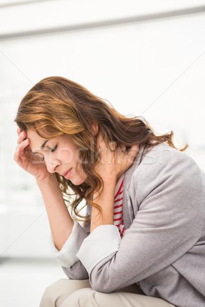Overworked casual businesswoman having a headache Stock photo © wavebreak_media