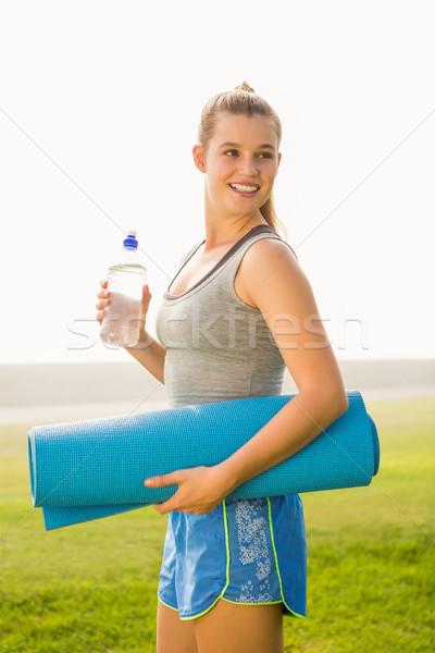 Sporty blonde holding exercise mat and water bottle Stock photo © wavebreak_media