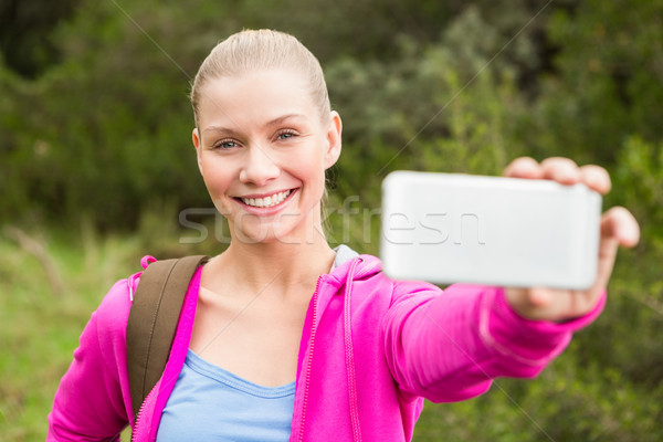 Smiling female hiker taking a selfie Stock photo © wavebreak_media