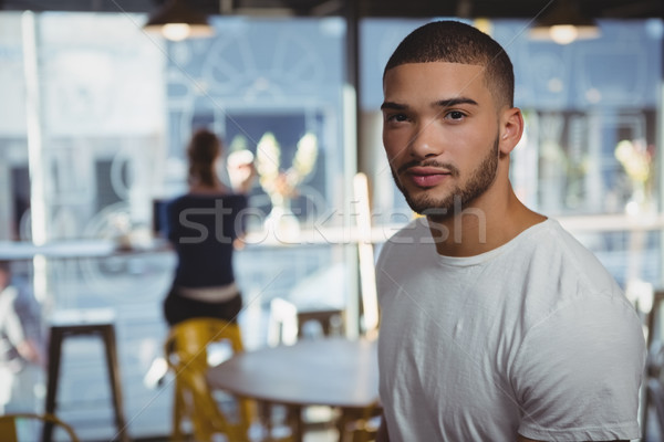 Portrait of man with friend in background at cafe Stock photo © wavebreak_media