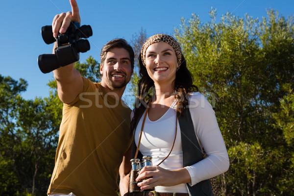 Happy couple with binoculars at forest Stock photo © wavebreak_media