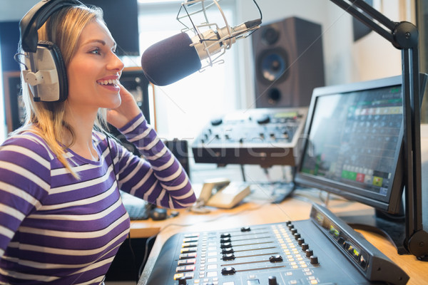Happy female radio host broadcasting in studio Stock photo © wavebreak_media