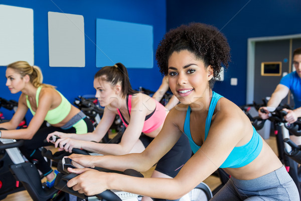 Stock photo: Fit people in a spin class