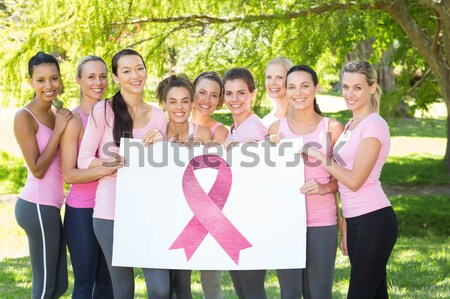 Pink ribbons with breast cancer awareness women Stock photo © wavebreak_media