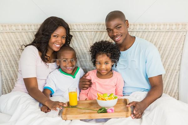 ストックフォト: 幸せな家族 · 朝食 · ベッド · 一緒に · 午前 · 少女