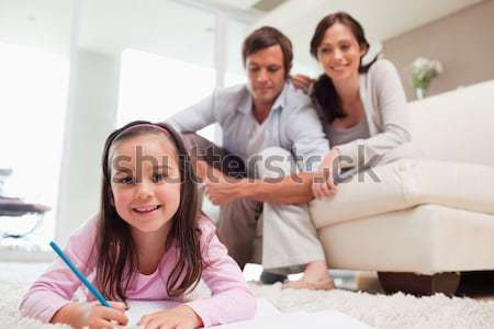Parents and daughter using electronic devices Stock photo © wavebreak_media