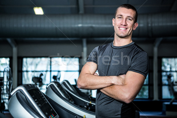 Muscular man on treadmill with crossed arms  Stock photo © wavebreak_media