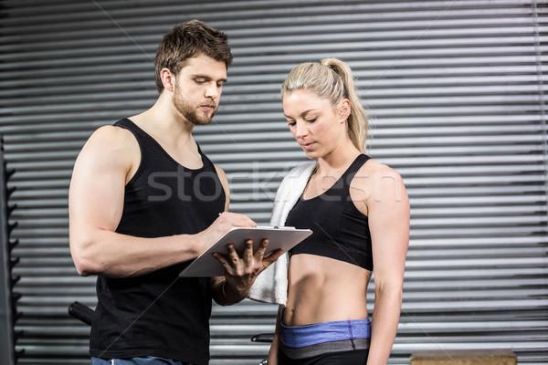 Smiling fit couple taking notes Stock photo © wavebreak_media