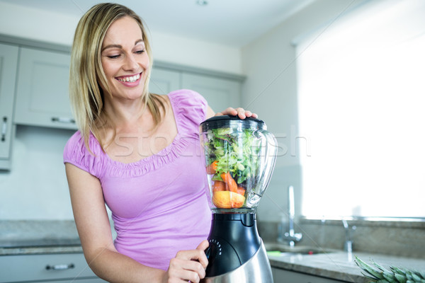 Pretty blonde woman preparing a smoothie Stock photo © wavebreak_media