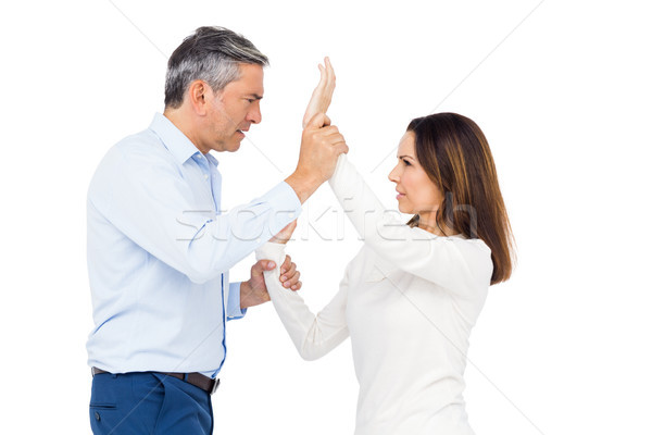 Violent man grabbing wifes wrists Stock photo © wavebreak_media
