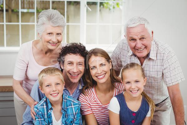 Happy multi-generation family against window at home Stock photo © wavebreak_media