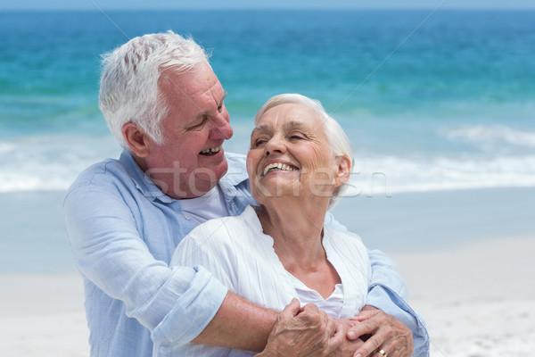 Senior couple embracing with arms around Stock photo © wavebreak_media