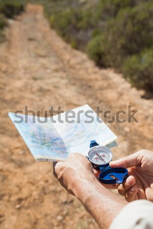 Woman checking map and compass Stock photo © wavebreak_media