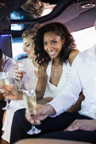 Vrouw drinken champagne limousine Stockfoto © wavebreak_media
